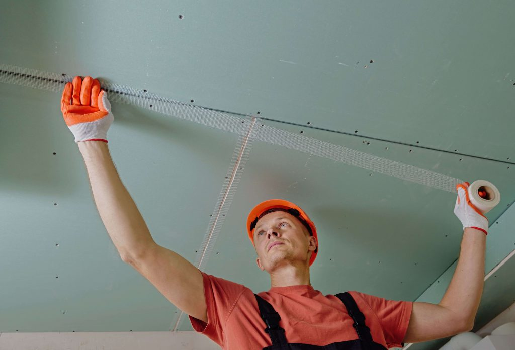Gyprock plaster tapping by a tradesman
